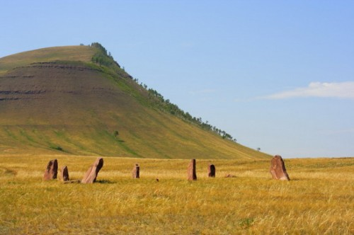 Ancient monuments of Khakassia on the hill background. Variant two.